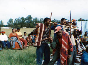 Sotho youths playing with sticks